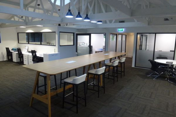 Boardroom and spacious collaboration area.