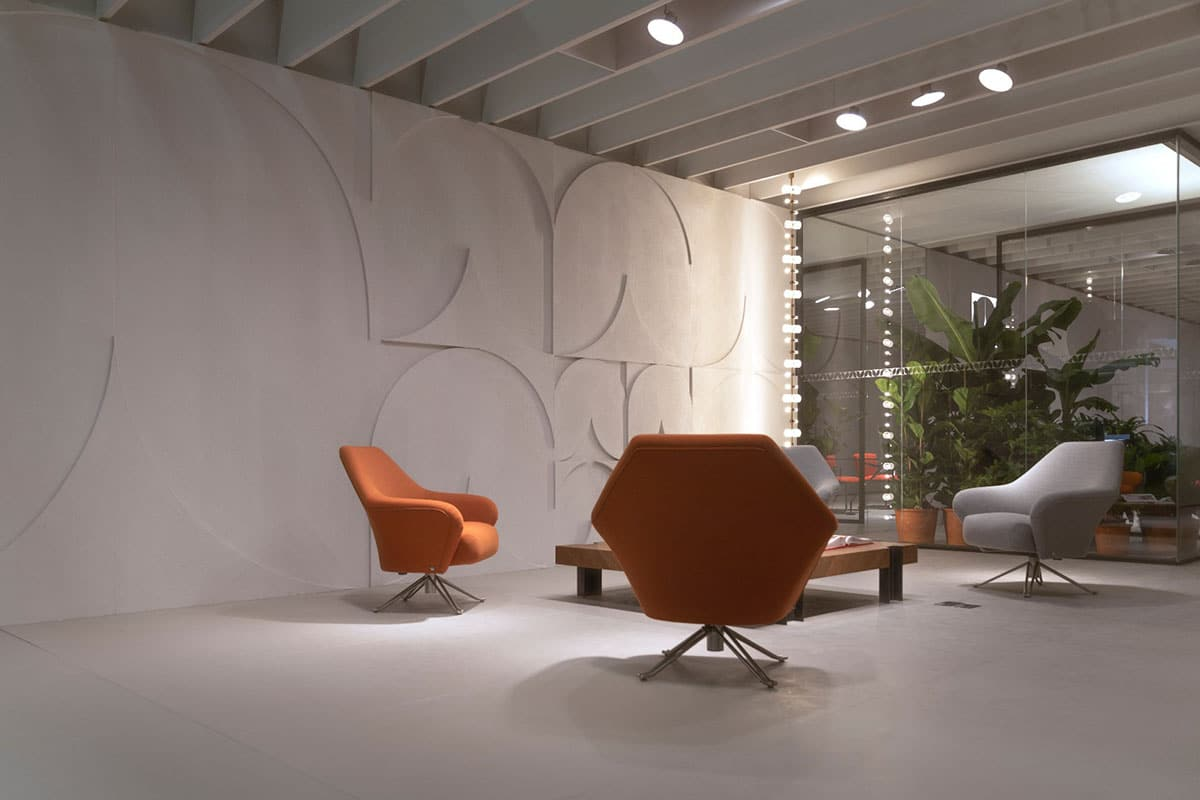 Modern orange and white chairs in office reception area with white carpet