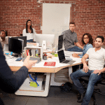 Office workers collaborate in a modern office environment
