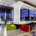 A view of a modern fit out with accents of vibrant colours